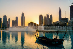 Dubai. In the summer of 2016. Arab Dhow on the background of the singing fountain in Dubai Mall. Royalty Free Stock Photography
