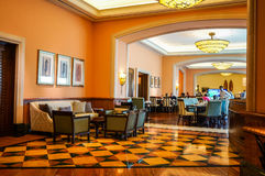 Dubai. Summer 2016. Bright orange color in the interior with marble floor of the hotel Atlantis The Palm. Royalty Free Stock Photo