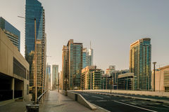 Dubai. In the summer of 2016. Construction of modern skyscrapers in Dubai Marina on the shore of the Arabian Gulf. Royalty Free Stock Photos