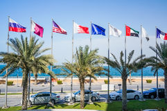 Dubai. In the summer of 2016. Flags in the green oasis on the Palm Jumeirah. Stock Photography