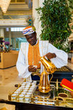Dubai. In the summer of 2016. The hotel employee pours Arabic coffee in the hotel Park Hyatt. Abu Dhabi. The hotel employee pours Arabic coffee in the hotel Park Royalty Free Stock Photo