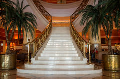 Dubai. Summer 2016. The interior with marble stairs in hotel Hilton Sharjah. The interior with marble stairs in hotel Hilton Sharjah Stock Images