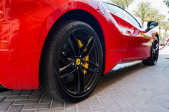 Dubai. Summer 2016. Luxury red car in front of the hotel Kempinski The Palm, Jumeirah. Ferrari red car in front of the hotel Kempinski The Palm, Jumeirah Royalty Free Stock Photography