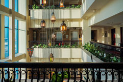 Dubai. In the summer of 2016. Modern and bright interior in the hotel Kempinski, Ajman. Designer chandelier in the lobby hotel. Stock Photos