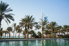 Dubai. Summer 2016. Water oasis on site Madinat Jumeirah Mina A Salam. A view of the famous hotel Burj al Arab. Water oasis on site Madinat Jumeirah Mina A Stock Images