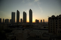 Dubai sunrise. Dubai skyscraper building with sunrise Stock Photo
