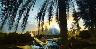 Dubai sunrise panorama with reptiles. Dubai city panorama sunrise with two reptiles, in yellow and blue duo tone color and originally blue skyscrapers at the royalty free stock images