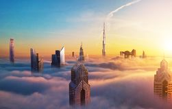 Dubai sunset view of downtown covered with clouds royalty free stock photos