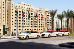 The Dubai Taxi cars waiting for clients near hotel Royalty Free Stock Photography