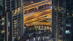 Dubai traffic at night timelapse with beautiful city. Dubai traffic on the overpass at night timelapse with beautiful city with lights close to it`s busiest stock video