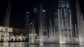 DUBAI, U.A.E. - JAN, 2018: amazing show of large fountains in night time, water jets are flying up stock video footage