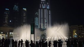DUBAI, U.A.E. - JAN, 2018: people are watching amazing show of huge dancing fountains in evening stock video footage