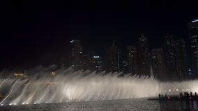 DUBAI, U.A.E. - JAN, 2018: water flows of spectacular show of large fountains in night time, unique performance stock footage
