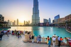 Downtown of Dubai with Burj Khalifa building at sunset. DUBAI, UAE - 1 APRIL 2014: Downtown of Dubai at sunset, UAE. Dubai is the most populous city in the Stock Photos