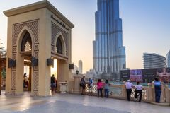Downtown of Dubai with Burj Khalifa building at sunset. DUBAI, UAE - 1 APRIL 2014: Downtown of Dubai at sunset, UAE. Dubai is the most populous city in the Royalty Free Stock Photography