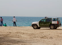 DUBAI, UAE - APRIL 16, 2012: A Dubai police car SUV at the Jumeirah beach.  Stock Photography