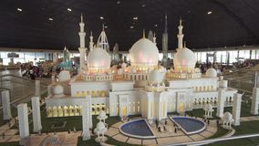 Exhibition of mock-ups Sheikh Zayed Grand Mosque made of Lego pieces in Miniland Legoland at Dubai Parks and Resorts. Dubai, UAE - April 01, 2018: Exhibition of stock video footage