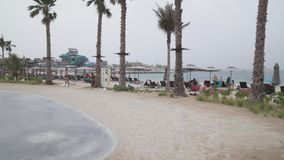 New beach and entertainment space La Mer stock footage video. Dubai, UAE - April 09, 2018: New beach and entertainment space La Mer opens to Dubai public stock stock video footage