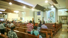 DUBAI, UAE - AUGUST 20, 2014: Catholic church during the service with people.. Christianity in Muslim countries. Stock Photos