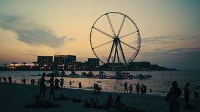 4K footage Dubai UAE Beach at dusk with silhouettes of people stock video