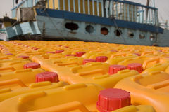 Dubai UAE Cooking oil waits to be loaded aboard a dhow headed for Iran or Somalia. Stock Image