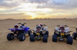 Riding quadbike on the Dubai desert royalty free stock photography