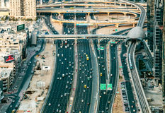 DUBAI, UAE - DECEMBER 08, 2015: Aerial view of Sheikh Zayed highway road in Dubai. With traffic in the evening. Aerial view on Dubai's complicated road Stock Images