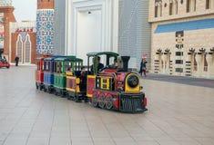 Children`s train in park entertainment center Global Village in. DUBAI, UAE - DECEMBER 4, 2017: Children`s train  in the park entertainment center Global Village Stock Images