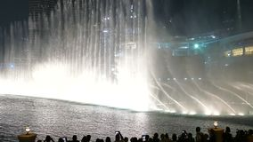 DUBAI, UAE - DECEMBER 7, 2016: The Dancing Fountain of Dubai near Burj Khalifa and Dubai Mall in downtown of Dubai.  stock video footage