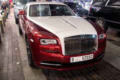 Royce Wraith next to Dubai mall. DUBAI, UAE - december 23, 2017: luxury car Rolls Royce Wraith next to Dubai mall. Rolls Royce is famous expensive luxury Royalty Free Stock Photography