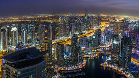 DUBAI, UAE - DECEMBER 14, 2015: Panoramic view of Dubai Marina district by night with skyscrapers Stock Photos