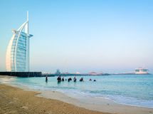 Scuba divers diving underwater next to Burj Al Arab on an early morning day in Dubai stock photography