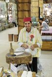 Shoemaker artisan in national clothes in the pavilion of Turkey. DUBAI, UAE - DECEMBER 4, 2017: Shoemaker artisan in national clothes in the pavilion of Turkey stock photos