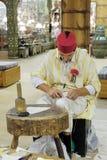Shoemaker artisan in national clothes in the pavilion of Turkey. DUBAI, UAE - DECEMBER 4, 2017: Shoemaker artisan in national clothes in the pavilion of Turkey stock image