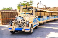 Sightseeing train awaits passengers at the Dubai Safari Park. Dubai, UAE - December 30, 2017. Sightseeing train awaits passengers at the Dubai Safari Park for a stock photo