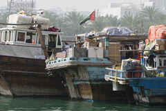Dubai UAE Dhows old wooden sailing vessels are docked along the Deira side of Dubai Creek. Stock Photography