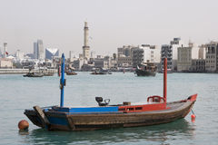 Dubai UAE empty abra anchored on Dubai Creek with minaret of Grand Mosque in distance Royalty Free Stock Photos