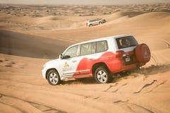 Desert safari near Dubai, UAE. DUBAI, UAE - February 18, 2018: Desert safari - driving off-road vehicles through the sand dunes, traditional entertainment for royalty free stock photography