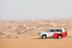 Desert safari near Dubai, UAE. DUBAI, UAE - February 18, 2018: Desert safari - driving off-road vehicles through the sand dunes, traditional entertainment for stock images
