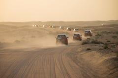 Desert safari near Dubai, UAE. DUBAI, UAE - February 18, 2018: Desert safari - driving off-road vehicles through the sand dunes, traditional entertainment for royalty free stock photo