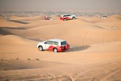 Desert safari near Dubai, UAE. DUBAI, UAE - February 18, 2018: Desert safari - driving off-road vehicles through the sand dunes, traditional entertainment for royalty free stock images