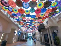 Dubai, UAE February 2019 - Umbrella Decoration in Dubai Mall. Ceiling of World`s Biggest Mall decorated by colorful umbrellas royalty free stock photography