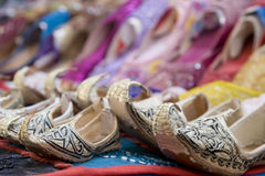Dubai UAE Genie style sandals for sale in Bur Dubai souq in women's and children's sizes Stock Photos