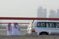 Dubai UAE group of Muslim men wearing traditional dishdash and gutras Royalty Free Stock Photos