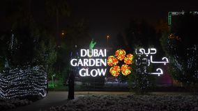 Dubai, UAE - January 13, 2018: luminous sign at entrance to largest unique theme Glow park with unusual concepts. Architectural art with nightlight in Dubai stock footage