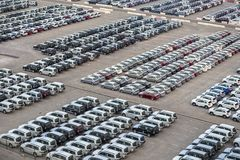 New cars in rows stored at port Rashid in Dubai, UAE stock images