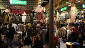 Dubai, UAE - January 12, 2018: night market clothing, fabrics and leather accessories next Global Village in Dubai city
