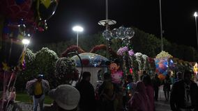 Dubai, UAE - January 18, 2018: tourist people buying souvenirs and glowing balloons in night Miracle Garden Dubai. Sale. Balloons with Disney characters in stock video