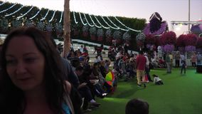 Dubai, UAE - January 18, 2018: woman tourist photographing music show on stage in evening Miracle Garden Dubai. Man. Saxophonist playing music at musical stock video footage