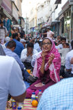 Dubai, UAE - July 16, 2016: Muslims gathering for a communal. Muslims gathering for a communal charity iftar organised on a street by a local mosque Royalty Free Stock Image